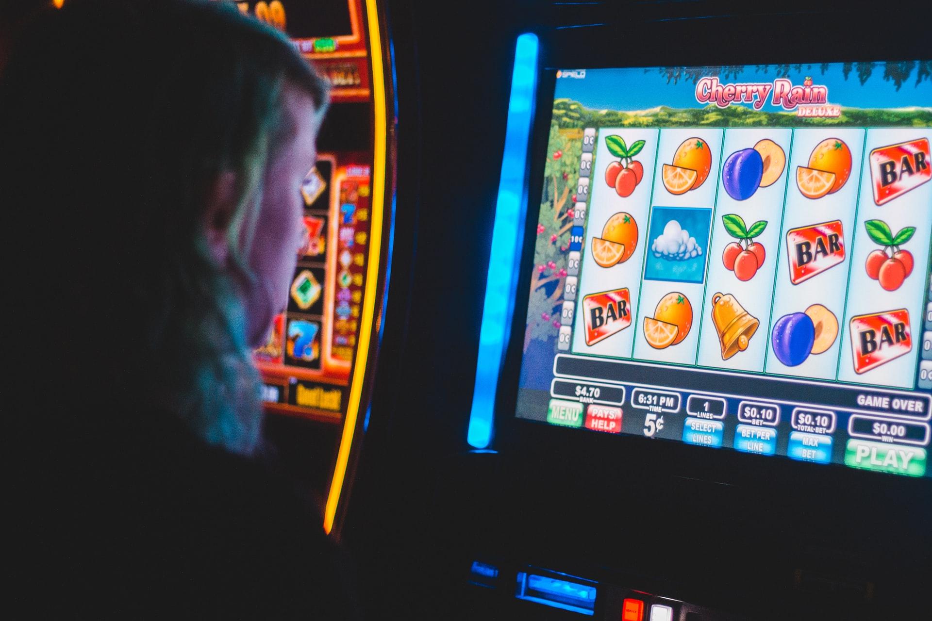 woman play slot machine